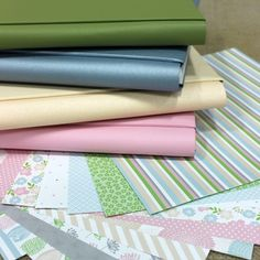 Pretty in Pastel Papers- they look like bolts of beautiful fabric to make a quilt! but they are indeed, photo albums with pretty papers. Now I want to go scrapbook!  http://www.creativememories.com/user/lanitamedina