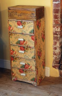 A Vintage American Wallpaper Chest blends with the Rich Mellow Decor of the Living Room