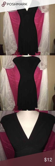 NWOT CHAPS BLACK V NECK FITTED DRESS SZ SML/PET This beautiful chaps black dress has a beautiful V-neck layover but the fabric it also has shoulder pads that are removable and it is 95% polyester and 5% elastane. It is a size petite small and is 38 inches from the shoulders with a fit and flair skirt! Chaps Dresses Midi