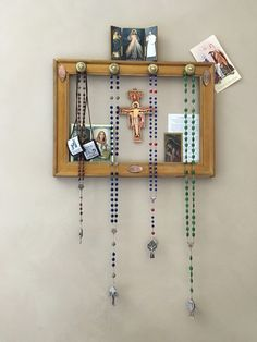 Home altar and rosary hanger made from an old picture frame and some drawer pulls. #Catholic #Rosary