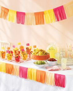 a Cinco de Mayo party will be festive with these tissue-paper decorations. You can make them in any color combination -- for very little dinero. party decoration ideas, fiesta party, paper garlands, food tables, color, mexican party, parti, paper decorations, cinco de mayo