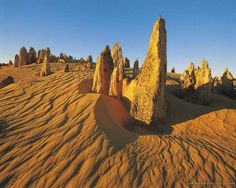 Pinnacles Desert in Nambung National Park, Australia. Pinnacles Desert is a desert that is a part of Western Austraila Nabun National Park. Millions of limestone clams that were formed in unusual protrusions by wind. Australia Travel, Western Australia, Pinnacles Desert, Nambung National Park, Australia Wallpaper, Places To Travel, Places To Visit, California Camping, Scenery Wallpaper