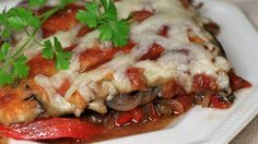 This recipe is for an herb-accented baked dish with eggplant, red bell pepper, and onion, topped with cheese.