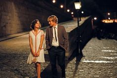 Midnight in Paris   Little light on the ending...but it's a perfect Woody Allen film based on that ending. Amazing Cinematography and Costume design!