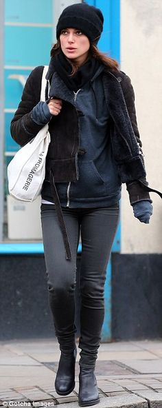 Chilly day: The actress got all wrapped up wearing a beanie hat, sheepskin jacket, hooded top, jeans and ankle boots