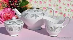 Royal Tuscan Rondeley pattern fine bone china teapot, milk jug & sugar bowl set.  White fine bond china decorated with a pale green and grey leaf pattern and platinum gilding.  One pint teapot.  There are straining holes in the spout so this teapot is suitable for both loose tea and tea bags.  Lidded sugar bowl and 6 fl.oz. milk jug.  All pieces are trimmed with platinum gilding.  Royal Tuscan Rondeley fine bone china, made by R.H.& S.L.Plant, Tuscan Works, Longton, Staffordshire, Eng...