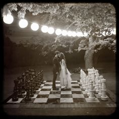 Oh. My. God. I need to get a large chess set to borrow for the wedding...if only just for pictures alone! With MASSIVE bistro lights! WAH!