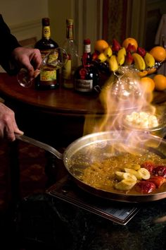 Banana Flambe, More recently, it's been offered live banana flambé stations. The bananas are served over housemade Tahitian vanilla ice cream and are truly out of this world! Guests love this because their food is lit on fire right before their very eyes.