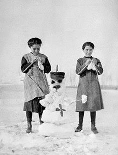 Knitting mittens for the snowman circa 1919.