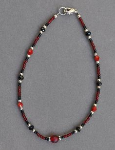 Hey, I found this really awesome Etsy listing at https://www.etsy.com/listing/208563309/red-and-black-bead-anklet