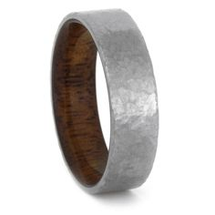 A hammered titanium wedding band with a comfort fit mahogany wood sleeve. This wood ring has a custom profile as all of my rings are made to order...