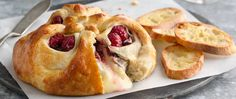 Enjoy this raspberry and cheese filled brie baked with Pillsbury® refrigerated crescent dinner rolls - serve warm with crackers!