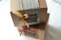 """wrapping paper """"wrap"""" on kraft box with label and ribbon accent"""