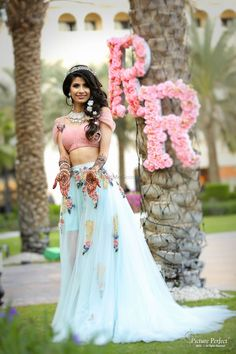 Looking for Pastel lehenga with Disney princess look? Browse of latest bridal photos, lehenga & jewelry designs, decor ideas, etc. on WedMeGood Gallery. Bridal Mehndi Dresses, Mehendi Outfits, Indian Bridal Outfits, Indian Designer Outfits, Bridal Lehenga, Indian Dresses, Wedding Dresses, Pool Party Dresses, Pool Party Outfits
