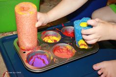 Painting with pool noodles and other educational play.