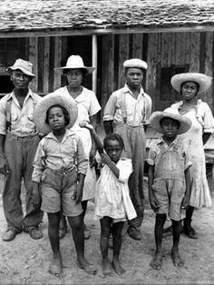 1 of 8 photos of this family. - Sharecropper Lonnie Fair and family. Photograph by Alfred Eisenstaedt. Scott, Mississippi,1936.