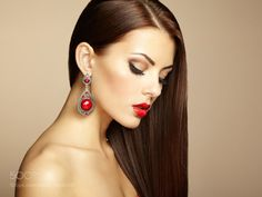 Portrait of beautiful brunette woman with earring. Perfect makeu by heckmannoleg
