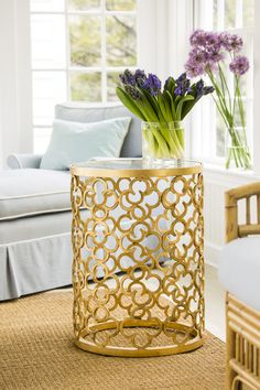 Decorative Crafts' hand-wrought iron table finished in gold leaf.