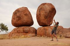 The Devils Marbles are huge granite boulders scattered across a wide, shallow valley