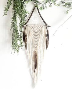 Wooden triangle macramé dreamcatcher, made from organic materials and natural forrest feathers. This item is handmade in high quality & with a lot of heart. Measurements: 29 × 93 cm ------------------------------------------------------- ☆ MADE TO ORDER! ☆ This piece is made to