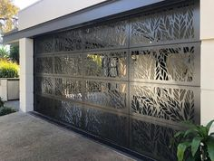 When you're required by Council to have a percentage of opening in your garage door for ventilation… Axolotl Graphite. Garage Door Design, Garage Doors, Phenolic Resin, Axolotl, Building Facade, Entry Doors, Three Dimensional, Terracotta, Concrete