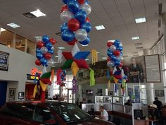 "Ford Fiesta Custom Display - Balloon Man LLC #ballooncreations  #customdesigns - We have put in a tremendous amount of study and development over the years to define the purpose Balloon Man's Showroom Balloon Decoration. When we have asked our customers; ""Why do you use balloons anyway?"" I get the same response almost every time - ""to make the showroom look more festive""."