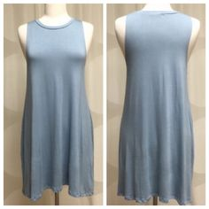 Dusty blue dress, perfect weight and so comfy You'll look and feel amazing in your new blue dress!  So easy to wear and you can do so much with it. Dress it up with some awesome jewelry or throw a jean jacket on and be adorable and sporty. 96% rayon and 4% spandex, it has a perfect weight. Heavy enough to hang nicely and not be sheer, and light enough to feel like you're wearing a t shirt. Sizes S-M-L. True to size. April Spirit Dresses