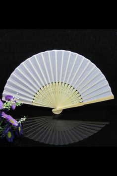 Keep the guests cool for a tropical wedding... Silk fans from eBay