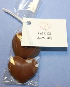 Two hearts. Wedding favors, anniversary favors, table favors, chocolate hearts. Chocolate heart gift bags. Custom tag with your personalized information.