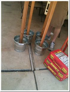 I really like this idea, especially the portability...Poles for lights - concrete in buckets
