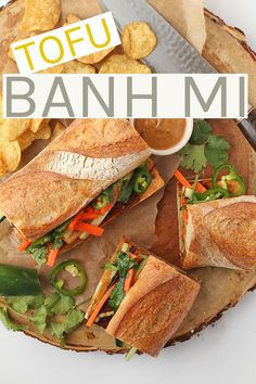 delicious French/Vietnamese fusion, this sandwich is made with marinated tofu, fresh cucumbers and carrots, and creamy Banh mi sauce. All inside a chewy baguette for a hearty and delicious vegan lunch. Vegan Sandwich Recipes, Tofu Recipes, Vegan Dinner Recipes, Vegan Dinners, Asian Recipes, Whole Food Recipes, Vegetarian Recipes, Cooking Recipes, Vegetarian Sandwiches
