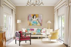 A Matti Berglund painting, commissioned by the homeowner, creates the focal point in the sunroom. The chandelier is by David Iatesta; the chairs are by Minton-Spidell.