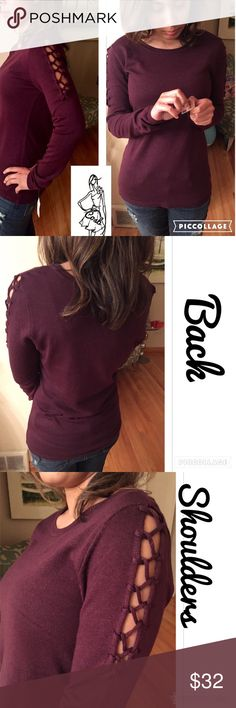 Cute Deep Wine Color Sweater w/Upper Lace Cute Deep Wine Color Sweater. Sweater has rounded neckline & stops @ end of waist, beginning of hips. Sleeves lace up from elbow up. Back is plain. Cosb Sweaters