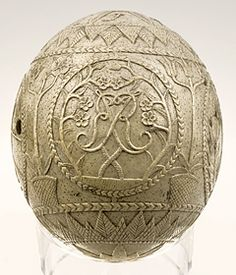 Jacobite Egg. Carved Ostrich Egg with Jacobite Symbols, Including: Thistles, Oak Leaves, etc... Carved in Memory of the Death of Prince James Francis Edward Stuart (1688-1766). Circa 1766-1767.