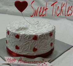 a mango gautex cake designed for an anniversary! flying heart was the main element.
