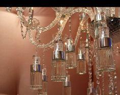 11 Brilliant 😁 Ways to Reuse Old Perfume 💐 Bottles like a Pro 👌🏼 . Empty Perfume Bottles, Glass Bottles, Wedding Favours Bottles, Bottle Chandelier, Furniture Fix, Perfume Store, Beautiful Perfume, Bottle Lights, Bottle Vase