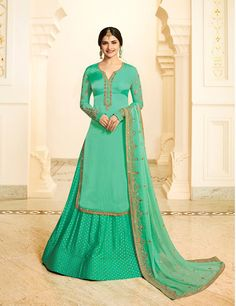 Prachi Desai Green Georgette Satin Lehenga with Silk Jacquard Palazzo Style Suit. This suit is adorned with zari and thread embroidery and stone work. Comes with a matching dupatta. Sharara Suit, Salwar Kameez, Salwar Suits, Arabic Dress, Lehenga Style, Kurti Neck Designs, Basic Outfits, Fashion Sale, Indian Designer Wear