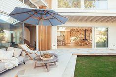 Backyard Reveal - Kyal & Kara : Kyal & Kara Stone Cladding, Timber Cladding, Coastal Gardens, Coastal Homes, Large Round Ottoman, Outdoor Spaces, Outdoor Living, Kyal And Kara, White Exterior Houses