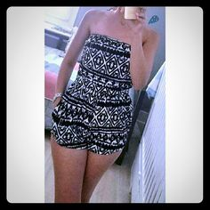 """Aztec Print Romper #422-BS Black and ivory Aztec print romper with pockets. 95% Rayon 5% Spandex. Made in U.S.A. Hand wash. Bust measured laying flat is 24"""" and it is elastic so it will stretch out 4"""" more. Waist 23"""" also elastic. Length 21"""". Always Me Pants Jumpsuits & Rompers"""