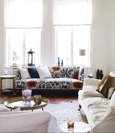 Let the light shine in. Statement floral printed couch among a sea of white.