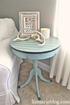 My mom just gave me a very similar table of my grandmother's - and it also has a scraped up top. Maybe I'll try something like this - so cute!!
