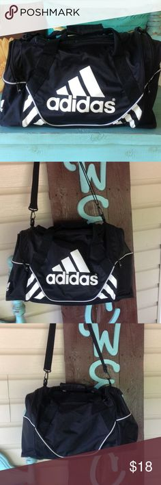 Adidas duffle bag. Adidas duffle bag, in good condition. Measures 21 inches in length and is 12 inches tall. Adidas Bags