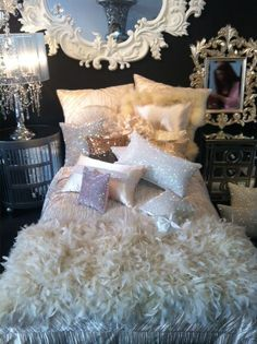 Cute guest room or bedroom inspiration. I like all of the layered whites and creams on the bed being brought in other areas of the room with the white frame over the bed.