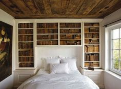 Fluffy bed surrounded by bookshelves. Sweet dreams.