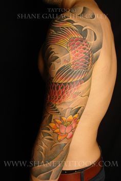 Colored Flower And Japanese Fish Tattoo On Left Sleeve