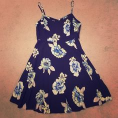 """Old Navy Blue Dress with Floral Print Old Navy Blue Dress with Floral Print. Flattering A Line structure. Comfortable on. I am 5'6"""" and the length hits a little above the knee. Old Navy Dresses Midi"""