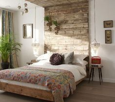 I love how it wraps up and over the bed. And the contrast of the raw barnwood against the very refind pendant lamps... ( lamps hung a bit too low for me;-)