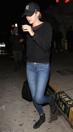 Incognito: Gigi Hadid opted for a demure look, sporting distressed jeans and a slouchy black sweater