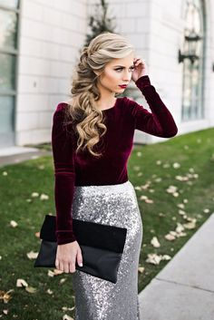a plum colored velvet long sleeve shirt, a silver sequin maxi skirt, a black suede and leather clutch