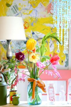 Love the chrome yellow and the flowers. Q. Designer Guild.